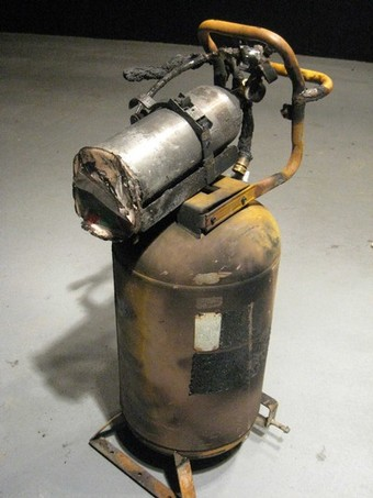 This undated police handout photograph shows a makeshift gas dispenser which Bruce Jeffrey Pardo used inside the Knollcrest house where he killed nine Christmas Eve party guests. Pardo, dressed as Santa Claus, had been divorced just a week when he unleashed a hail of gunfire and flames that seemed intended for his former wife and in-laws, officials said on Friday. After running out of bullets, Pardo used the makeshift gas dispenser to spray the inside of the home with a combustible vapor consisting partly of auto-racing fuel, which quickly ignited in an explosion, gutting the dwelling, police said. REUTERS/Covina Police Dept/Handout (UNITED STATES). FOR EDITORIAL USE ONLY. NOT FOR SALE FOR MARKETING OR ADVERTISING CAMPAIGNS.