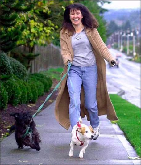Mary Vincent walks her two dogs, Danny, left, and Mikey. Mary, in agonizing pain, bleeding profusely, did not die. She slowly made it to the road where a stranger rushed her to the hospital.